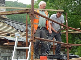 Peter Hughes and Richard Thomas repairing the roof