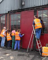 Kids Training week repairing and painting the loco shed doors
