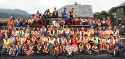 Kids' Training Week group pose round one of the railway's locomotives